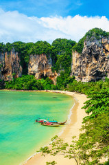 Amazing Railay Beach with mogotes, long tail boat and high palm