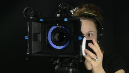 pretty woman with a professional movie camera