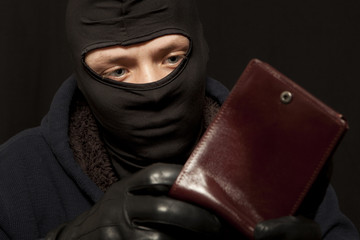 Thief with a purse