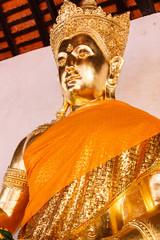 golden buddha statue wearing crown