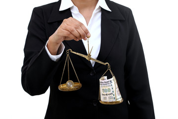 Business woman holding the justice scale