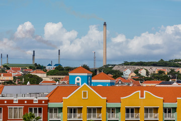 Heavy Industry Over Colorful Curacao Resorts