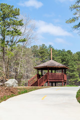 Wood Gazebo in Park Beyond Concrete Path