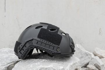 Special force Modern combat helmet on white rocks  ground