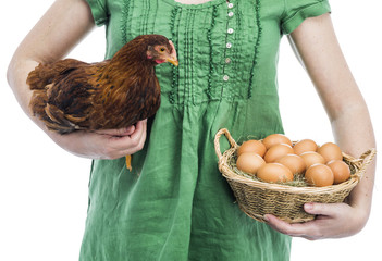 Woman holding chicken and eggs