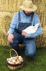Farmer with hen