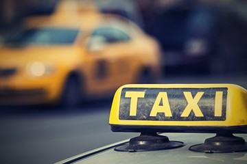 sign of a taxi with digital retro effect