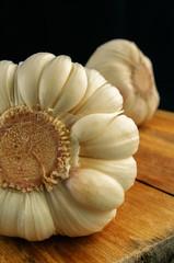 Garlic bulb on a kitchen board.