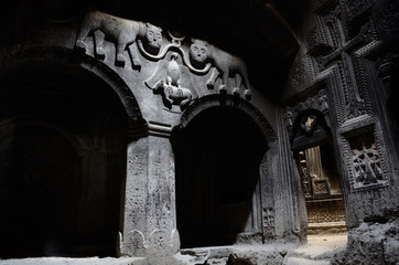 hall of ancient christian temple Geghard with columns,Armenia