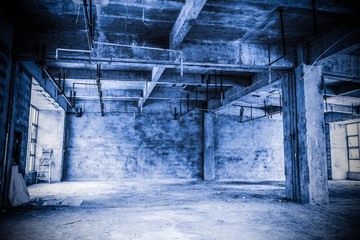 Empty industrial loft in an architectural background with bare c