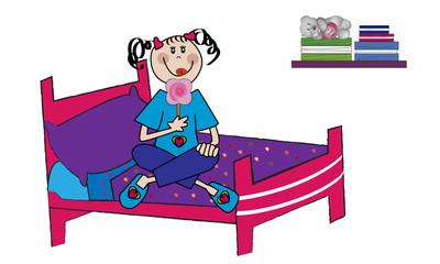 Niña feliz sentada en la cama comiéndose una piruleta