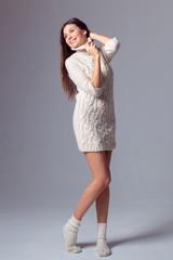 Beautiful girl in a sweater dress