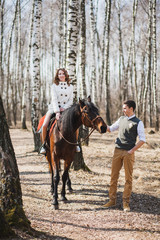 romantic walk of bride and groom, woman riding brown horse