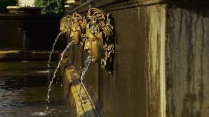 Human heads fountain in park Peterhof