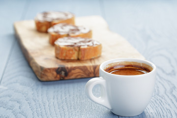 simple breakfast with cup of espresso and baguette slices with