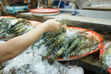 tiger prawn, Raw fish and prawn selling on ice in fresh market