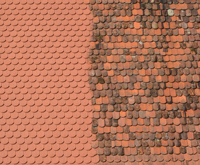 New against old roof tiles - Roof renovation concept