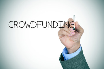 man writing the word crowdfunding