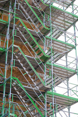 Old building with scaffolding undergoing repair