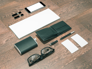 Every day carry man items collection: glasses, wallet, flask .