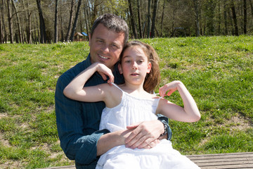 Girl, 10 years old with her father outside