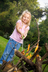 Camping: Little Girl Cooking Hot Dogs Over Campfire