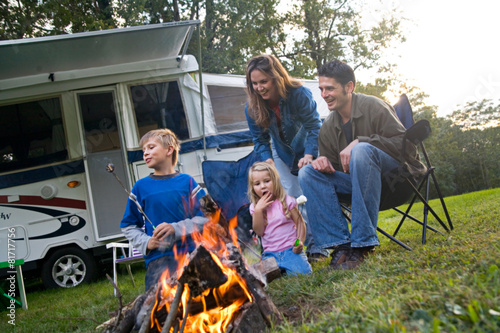Camping: Family Having Fun With Marshmallows By The Fire - 81717756