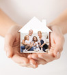 close up of hands holding house shape with family - 81717930