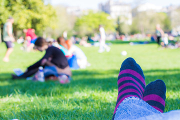 colored socks of a teenager who is resting in a park