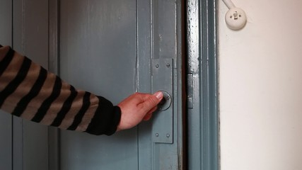 Detail of hands closing a door
