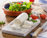 Goat cheese with salad and tomatoes