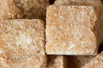 Rushy raw sugar cubes close up