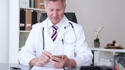 doctor working at the hospital and using smart phone