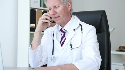 Doctor chatting on his mobile phone