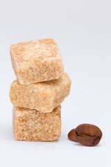 Cubes of rushy brown raw sugar isolated