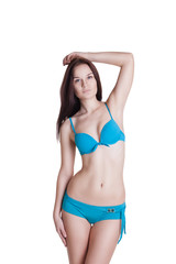 Portrait of a beautiful brunette girl wearing blue bikini