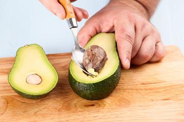 Chef extracts bone of avocado