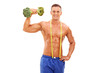 Handsome young athlete holding a broccoli dumbbell