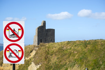 warning signs for surfers at ballybunion castle