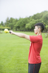 Strong young man exercising with kettle bell weights