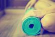 Zdjęcia na płótnie, fototapety, obrazy : Young woman holding a yoga mat