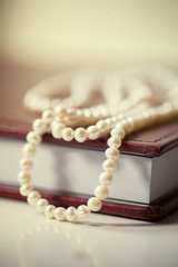 Book with a pearls bead close up