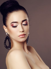 sensual woman with dark  hair and bright makeup, with bijou