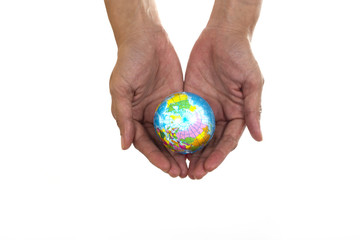 Earth planet in african female hand