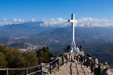 Cross on the mountain over city in Jaen