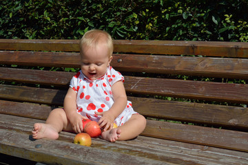 blonde toddler laugh and sort apples