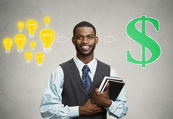 man holding books has ideas ready for financial success