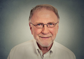 Portrait of happy Old Man with glasses on gray background
