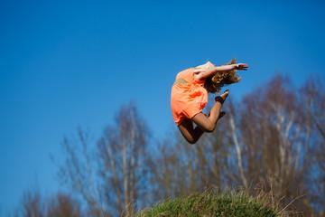 Young gymnast doing exercises