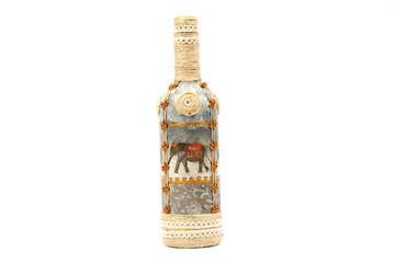 Decoupage bottle on white background